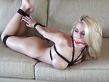 Bound,  Gagged And Butt Plugged Blonde.