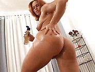 Oiled Red Haired Bitch Goes Solo And Takes A Dildo To Pet Her Cu