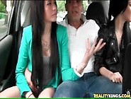 Two Young Brunettes Suck Cock In The Car