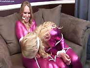 Bondage Struggle In Hot Catsuits