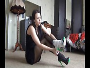 Girl Desperately Bandaging Over High Heel After A Terrible Sprai