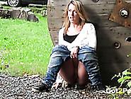 Light Haired Bonny Harlot In Jeans Pisses Sitting On Ground