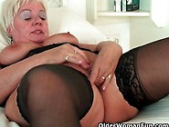 Chubby Granny With Big Tits Wears Black Stockings And Masturbate