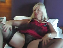 Mature Blonde In Lingerie Toys Herself