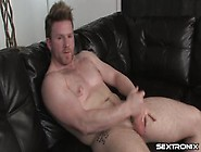 Tattooed Gay Hunk Mike Oxlong Masturbates On The Couch Solo