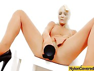 Blonde Babe Covered In Nylon Fucks Black Dildo