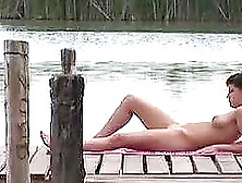 Sweet Betty Fists Her Tight Pussy Lying On A Pier