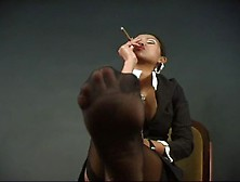 Asian Babe In Nylons And Business Attire Smoking A Cigar. Mp4