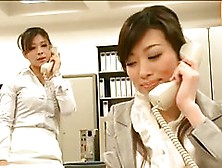 Asian Woman Puts On A Strap-On And Starts Fucking Her Secretary,