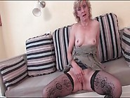 Lovely Mature In Fishnet Stockings Masturbates