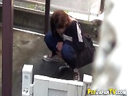 Asian Peeing In Carpark