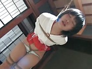 Tied Up Asian Chick Hanging From The Ceiling
