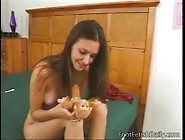Cute Brunette Plunges Dildo Into Her Wet Pussy