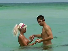 Delta White Is A Busty Blonde That Is On The Beach With Her Boyf