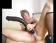 Solo Mature Having Fun With Dildos