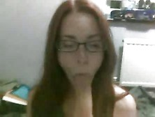 Red Head In Glasses Give A Blowjob