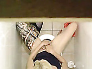 Voyeur Catches Horny Blonde Masturbating In The Toilet