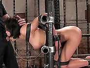 Ruby Knox Gets Her Pussy Drilled While Being Chained In A Pillor