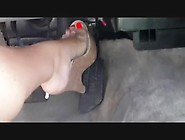 Woman With Bright Red Nail Polish And Platforms Plays With The P