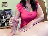 Dark Haired Woman Is Rubbing A Rock Hard Cock While Her Partner