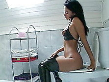 A Bad Girl In Thigh High Boots Gets Fucked In A Bathroom