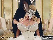 Blonde With A Mask,  Kelly Madison Is Rubbing Her Tits,  While Get