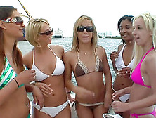 Beautiful Lesbians In Bikinis Kissing On A Boat