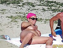 Naked Woman Are Enjoying On The Beach,  Although Some Guys Are Ar