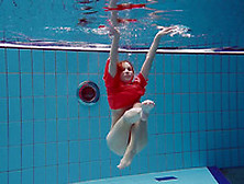 Slender And Cute Redhead White Girl Dives In The Pool And Undres