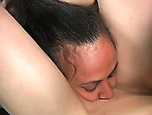 Tattooed Brunette Slut Licks Her Mistress's Toes And Pussy