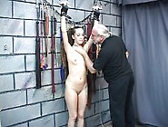Young Brunette Slave Has Er Niples Bound With String.