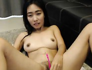 Cute Asian Camgirl Fucks Her Pussy Using A Sex Toy