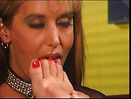 Lesbian In Leather Corset Enjoys Toe Sucking