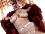 Sassy Brunette Girl Chrissy Marie Is Wearing The Fur Coat On The