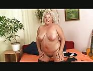 An Old Blonde Granny Masturbates With Black Dildo!