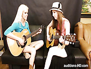 Two Young Lovely Coeds Wanna Learn Playing A Guitar