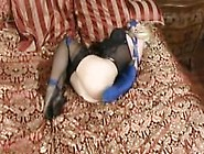 Emily Addison Chained In Blue Armbinder And Panel Gag