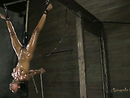 Oil Covered Nympho Gets Hung Upside Down And Gets Her Pussy Stim