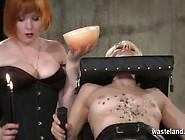 Redhead Lesbian Mistress Gives Blonde Hot Wax Treatment