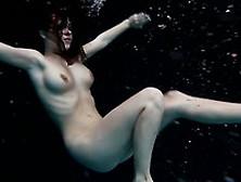 Busty Sizzling Hot Brunette Teen Undressing Underwater