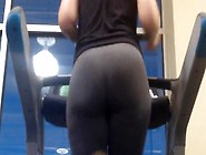 Curvy Blond Runs On A Treadmill At The Gym In Gray Yoga Pants