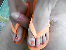 Footjob From Girl In Orange Flip Flops And Orange Toenails