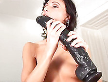 A Tight Brunette Uses A Massive Toy To Slam Her Pussy