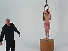 Longhaired Bondage Brunette With Small Tits Stands On Pedestal F