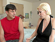 A Milf With An Amazing Rack Enjoys A Younger Guy's Cock