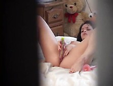 Girl With Pierced Nipples Uses Toys In Voyeur Video