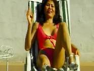 Rosy rocket has some poolside fun with a midget