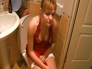 Girl In Red Dress Farting On Toilet